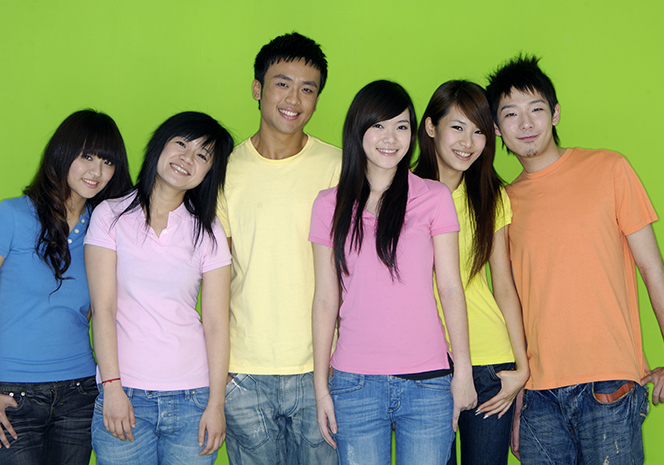 Group of six students on green background